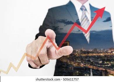 Double exposure, Businessman drawing a rising up arrow by finger, representing business growth