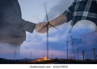 Double exposure businessman and engineer hands hake over windmill power energy