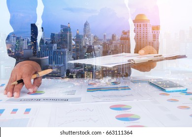 double exposure Businessman examine finance tax statistics and city scape. analytic research for restructure concept