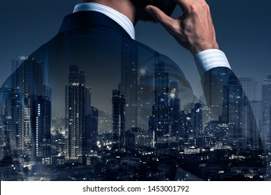 double exposure of businessman in formal suit with downtoen modern building city smart comunication ideas concept