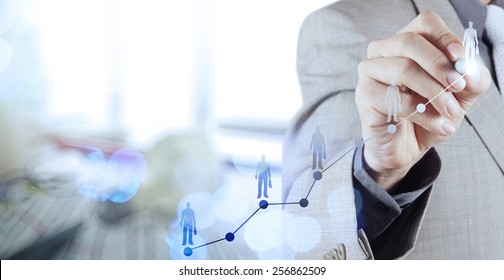 Double exposure of businessman hand choosing people icon as human resources concept