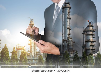 Double exposure of businessman hand hold tablet, Energy generating Factory and sunset as technology and energy concept.