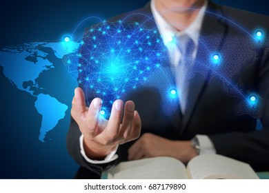 Double exposure of businessman hand hold light blue polygon brain and line node networking world map as business, globalization, technology, communication, innovation and knowledge concept