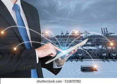Double exposure of businessman hand holding digital tablet assistance control logistics system use for import, export and logistics background