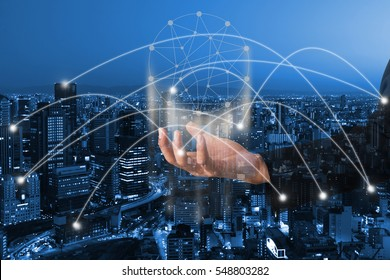 Double exposure businessman hand on city and line global network. Bitcoin and blockchain technology concept