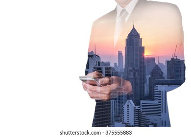 Double exposure of businessman hand touch screen smart phone, mobile, city and sunset as communication concept.