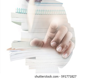 Double exposure of businessman hand working on touch screen concept, stack of book isolated on white background