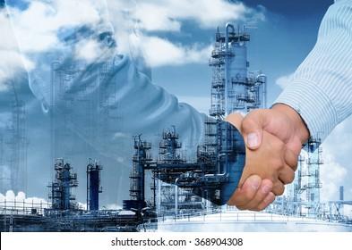 Double exposure of businessman handshake on industrial background.