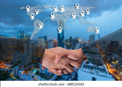 Double exposure of a businessman handshake with world global cartography globalization and map pin flat network conection concept on Bangkok cityscape in business district at night background