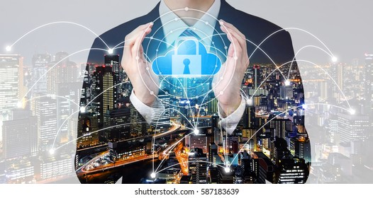 Double exposure businessman hold cloud symbol and padlock between hands with city overlay and connected line background - security storage concept
