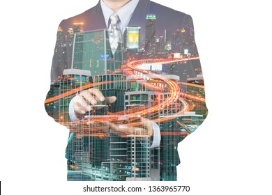 Double Exposure of Businessman hold Digital Tablet Device analyze real Estate market trend and City Building skyscraper as modern investor management with Highspeed Internet Technology