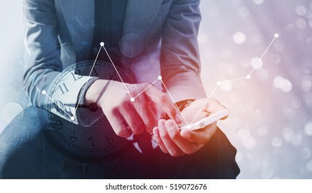 Double exposure of businessman holding smart phone with a row of stack money coins and analog clock with business graph information diagram concept for business finances and saving money. - Shutterstock ID 519072676