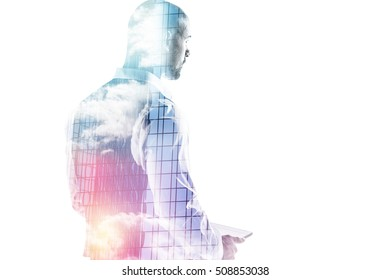 Double exposure of businessman holding a tablet pc isolated on white