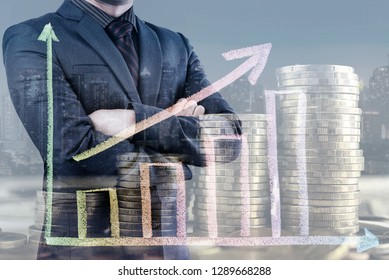 Double exposure of Businessman man with stack of money coins and growth graph, city night background. Money saving and investment concept.