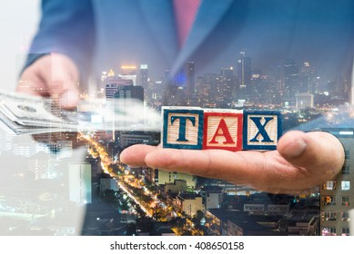 Double exposure of Businessman and money with TAX word on hand, city night background