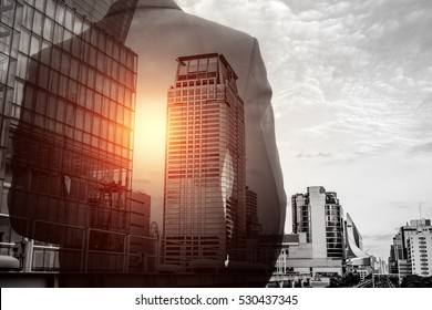 Double exposure of businessman in suit and Bangkok city cityscape. He's looking for his success in business and idea for life