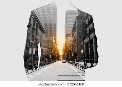 Double exposure of businessman in suit and cityscape. He's looking for his success in business and idea for life