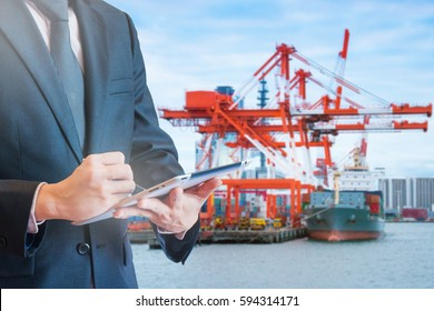 Double exposure of businessman touching tablet for analyze and checking stock at logistics port background, transportation trading business concept, world map element of this image furnished by NASA