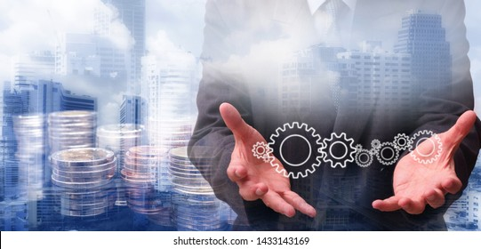 Double exposure of Businessman touching technology interface with gear wheel setting International financial consulting and rows of coins for finance and banking concept with business background.