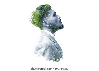 Double exposure of businessman and tree