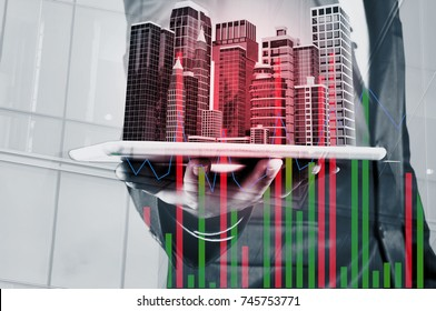 Double Exposure of Businessman use Digital Wireless Smart Touch Screen Tablet with Modern Building as Real Estate Project Development or Construction Concept.