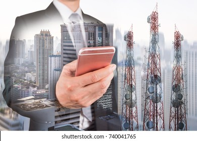 Double exposure of businessman use smartphone, communication tower or 4G 5G network telephone cellsite and foggy cityscape urban background as business, technology and telecom concept