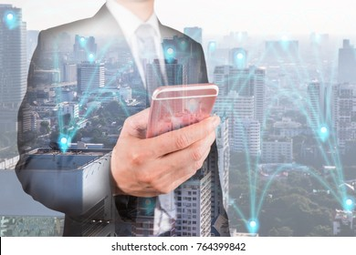 Double exposure of businessman use smartphone, communication 4G 5G node networking telephone cellsite and cityscape urban at foggy morning as business, technology and telecom concept
