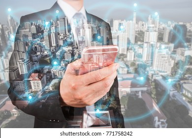 Double exposure of businessman use smartphone, communication 4G 5G node networking telephone cellsite andcityscape urban at foggy morning as business, technology and telecom concept