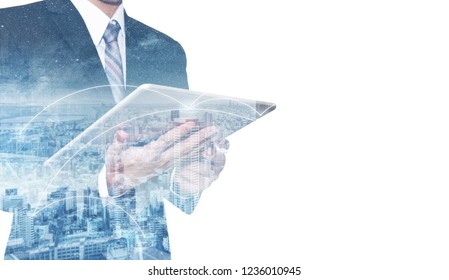 Double exposure businessman using digital tablet, and cityscape. Business network and communication technology