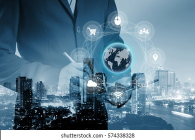 Double exposure of businessman using digital tablet with Multi channel banking payment communication ads network digital technology via internet wireless application development mobile smartphone app.