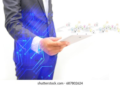 Double exposure of Businessman using digital tablet connect global internet telecommunication