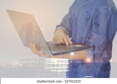 Double exposure of businessman using laptop with Construction site background