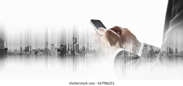 Double exposure businessman using smart phone, with city backgrounds