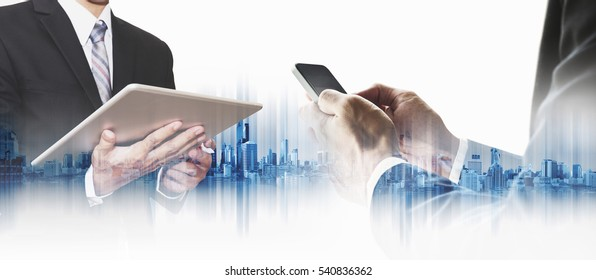 Double exposure businessman using smartphone and digital tablet with city, business communication technology concepts
