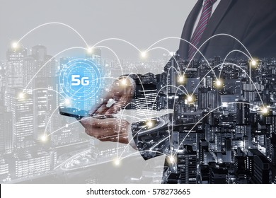 Double exposure businessman using smartphone with 5G network and city overlay background with connected line