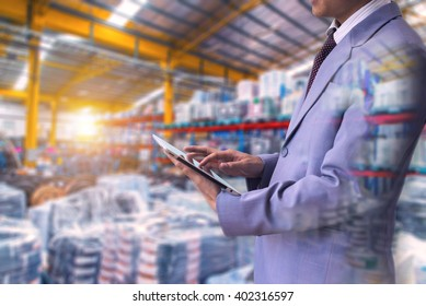 Double exposure of businessman using the tablet with warehouse and manufactory on blurred warehouse and manufactory background, Business Control warehouse for export concept