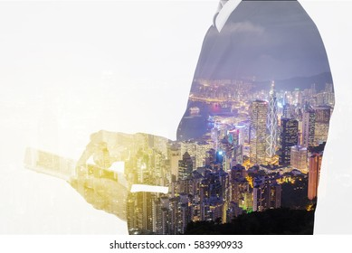 Double exposure of businessman using the tablet against the city