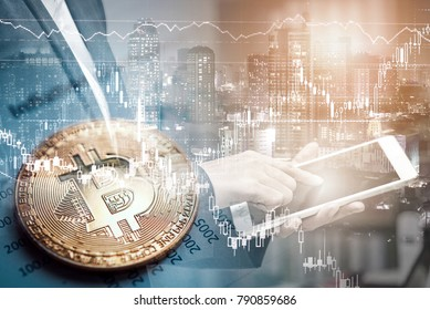 Double exposure of businessman using tablet and city night background with bitcoin on graph report, bitcoin BTC the new virtual electronic money. investment concept