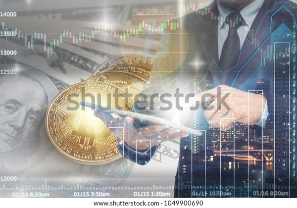 Double exposure of businessman using the tablet with Bitcoin exchange of trading screen on Closeup Bitcoins mockup on the money paper bank of various country, cryptocurrency and investment concept