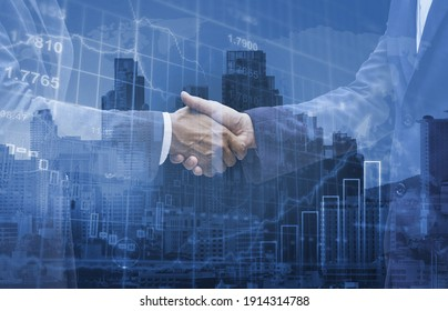 Double exposure businessman wearing suit handshake show best cooperation in business with growth investment graph, business partnership concept.