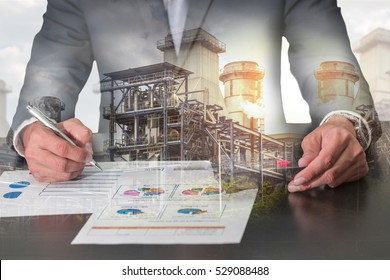 Double exposure of businessman working with document, calculator for analyze in the work, electric Generating Factory, Power Reactor and sunset as industrial, energy, analysis and commitment concept.