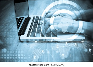 double exposure of businessman working with laptop,smartphone,laptop and row of coins with diagram and digital interface in finance and business concept