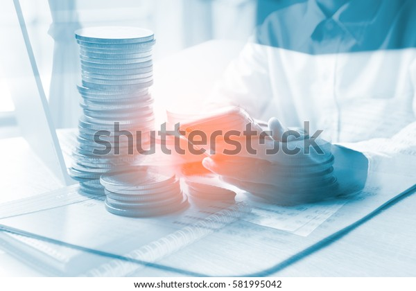 Double exposure of businessman working at office with step of coins. Concept business and finance