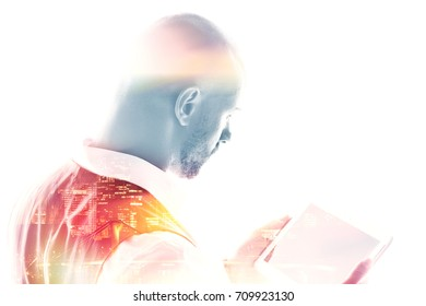 Double exposure of businessman working on a tablet isolated on white