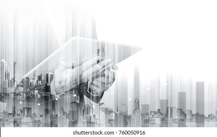 Double exposure Businessman working on digital tablet with modern buildings. Business growth and investment