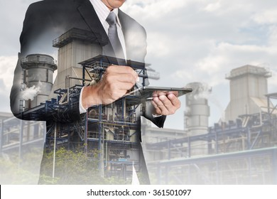 Double exposure of businessman working with tablet and  Electric Generating Factory, Power Reactor as energy, communication and technology concept.