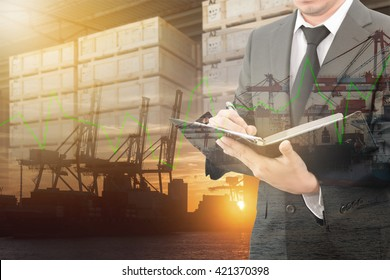 Double exposure of businessman writing notebook with blurred cargo in wooden case and transportation port background, trading export abroad concept