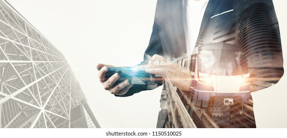 double exposure of businessmen using smart phone with traffic connection