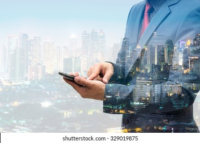 double exposure of businessmen using smart phone with blur city night