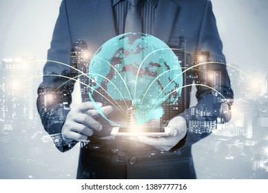 double exposure of businessmen using tablet and globe simulation with blur city night, network technology connection concept.